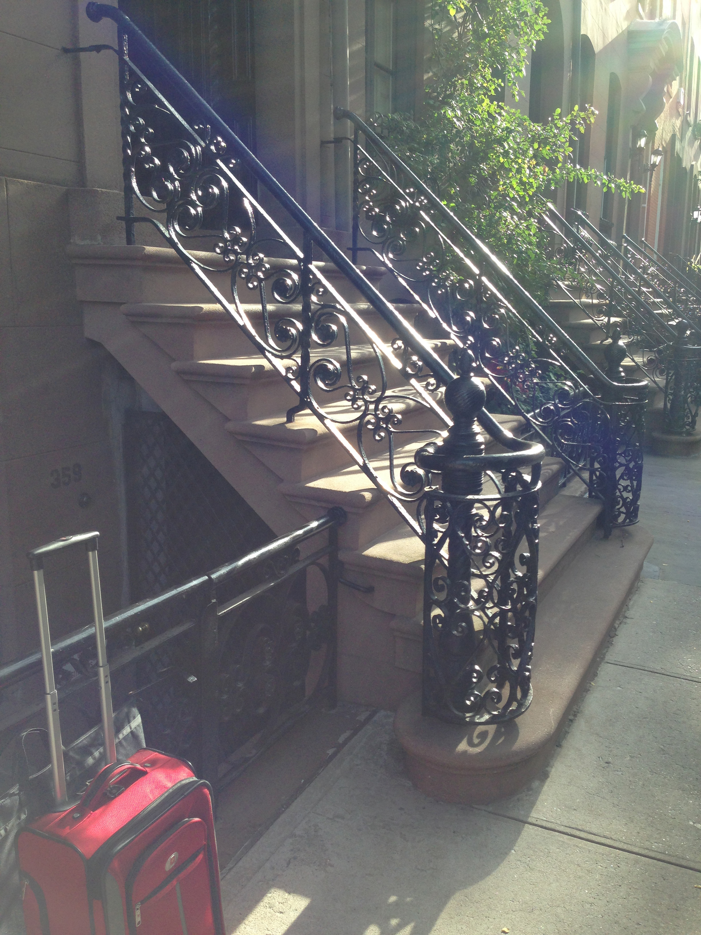 photo of New York City stoops and iron deco bannisters